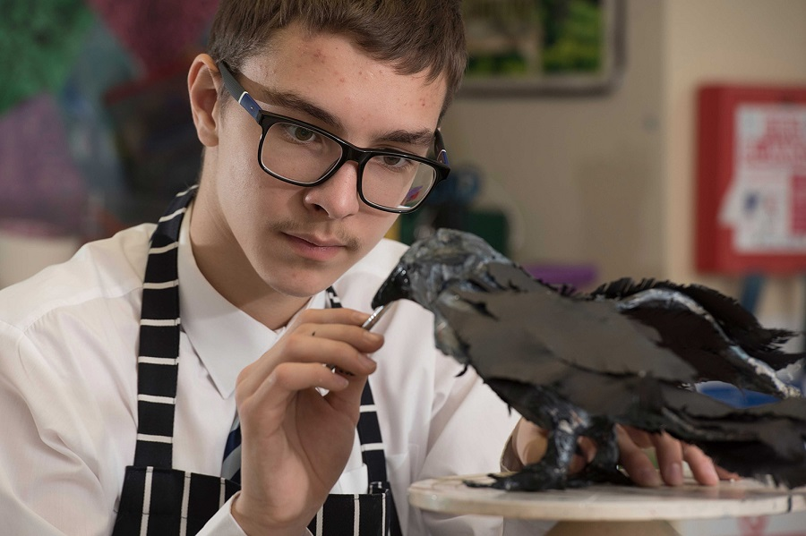900 International Student Painting Crow in Art Class